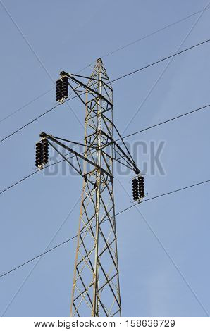 Lattice-type steel tower as a part of high-voltage line. Overhead power line details. The structure used to transmit electrical energy in electric power transmission and distribution