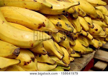 Ripe banana heap in city market in Birmingham