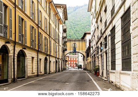 ITALY. COMO - APRIL 21, 2016: The picturesque city street with old beautiful houses. Como - the city of the Italian region of Lombardy.