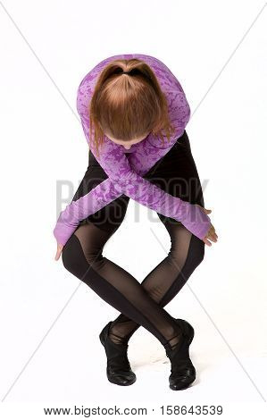 Woman doing yoga with folded hands and feet studio shot isolated on a white background