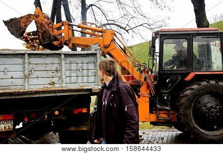 Kyiv Ukraine - December 02 2007: Tractor loading extinguished candles near the memorial to the victims of Holodomor 1932 -1933. Ukrainian nation commemorates the victims of famines (Holodomors) and political repression