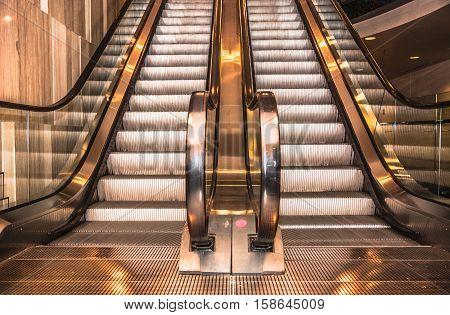 Modern escalator in shopping mall for brackground poster