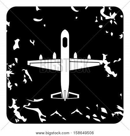 Large aircraft with missiles icon. Grunge illustration of plane vector icon for web design