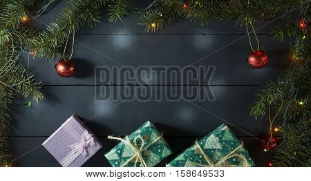 Christmas composition with Christmas tree branches Christmas toys and gifts. On a blue wooden background