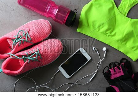 Clothes and items for sport on table