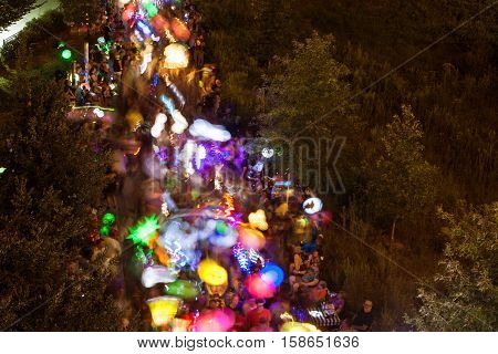 ATLANTA, GA - SEPTEMBER 2016: Motion blur of hundreds of people walking with colorful lanterns at night along the Beltline in the annual Atlanta Lantern Parade in the Old Fourth Ward in Atlanta GA on September 10 2016.
