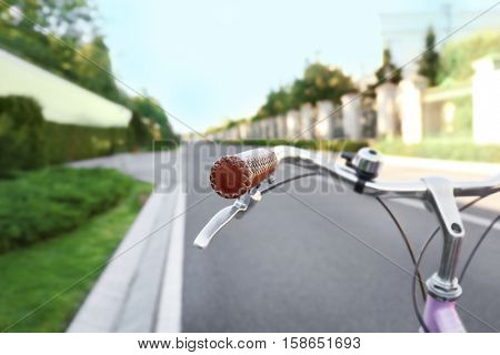 Bicycle on asphalt road, close up view