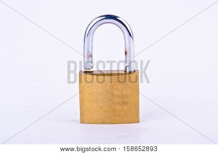old brass padlock or master key on white background tool isolated