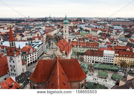 Aerial view over the roofs of Munich Old Town Hall and Heiliggeistkirche