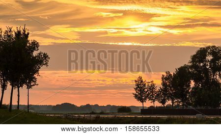 Sunset along old dyke in Netherlands near Kampen