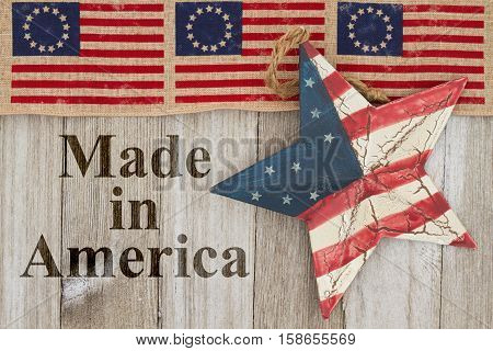 Made in America message USA patriotic old Betsy Ross flag old star and weathered wood background with text Made in America