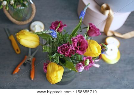 Beautiful bouquet of flowers on table in floral shop