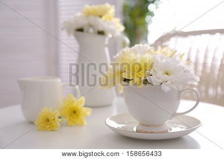 Flower bouquet of chrysanthemum in cup on table
