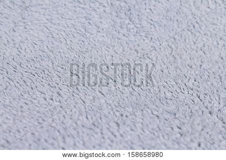 Closeup view of towel. Fluffy white background