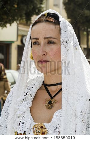 QUARTU S.E., ITALY - September 21, 2014: Parade of Sardinian costumes and floats for the grape festival in honor of the celebration of St. Helena. - Sardinia - portrait of a beautiful woman in traditional Sardinian costume
