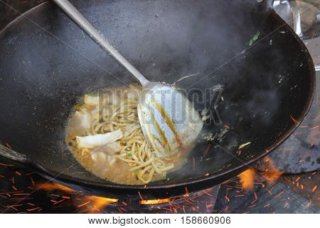 Traditional Indonesian noodle godok snacks fast food bakso cook soup