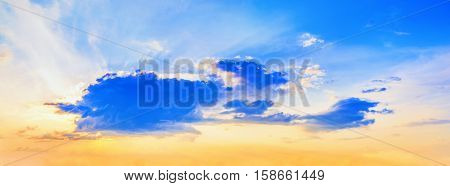 Bright colorful sunset with cumulus clouds. Lovely sky. Panoramic shot.