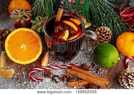 Hot Mulled wine with cinnamon sticks, orange, lime. christmas concept