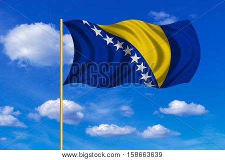 Bosnian and Herzegovinian national official flag. Patriotic symbol banner element. Correct colors. Flag of Bosnia and Herzegovina on flagpole waving in the wind blue sky background. Fabric texture. 3D rendered illustration