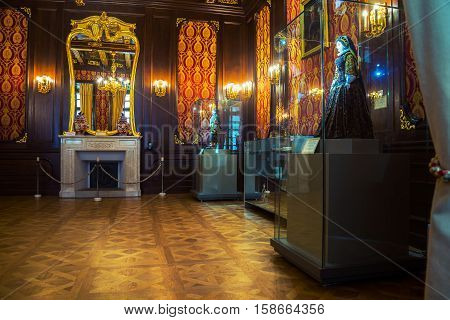NESVIZH, BELARUS - DECEMBER 19, 2015: Inside a Nesvizh Castle in Belarus. Beautiful interior decorations, mirror on the wall. Popular landmark
