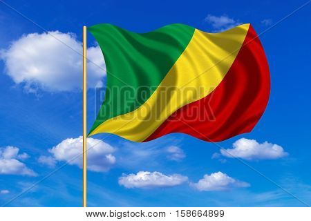 Congo Republic national official flag. African patriotic symbol banner element. Correct size color. Flag of Republic of the Congo on flagpole waving in the wind blue sky background. Fabric texture. 3D rendered illustration