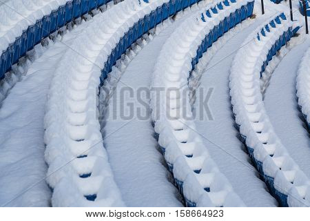 amazing fragment of abstract view of amphitheater seats at winter time, covered with thick layer of snow