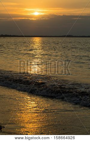 Fantastic gold sunset and solar path on the ocean beach - seascape. Islands Fiji.