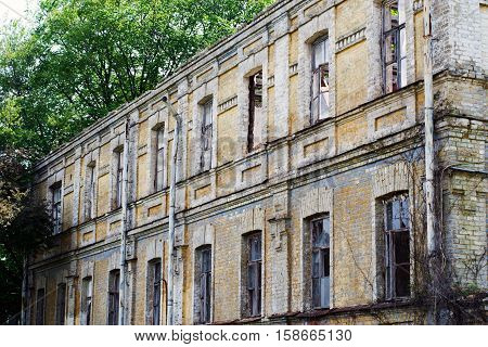 old two-storey ruined house with lots of windows