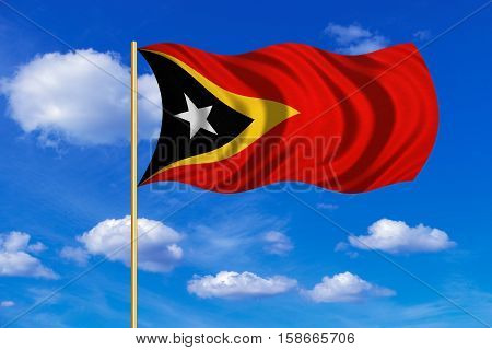 East Timorese national official flag. Patriotic symbol banner element background. Correct colors. Flag of East Timor on flagpole waving in the wind blue sky background. Fabric texture. 3D rendered illustration