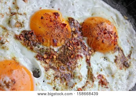 Fried eggs  with red hot chilly pepper