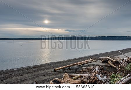 Clouds obscure the sun on and overcast day on the Puget Sound in Washington State.