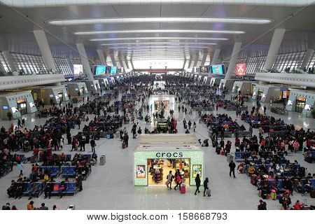 HANGZHOU - FEBRUARY 21: Passengers waiting for the train in the hall. Hangzhou East railway station is one of the largest railway hub in Asia, in Hangzhou, China, February 21, 2016.