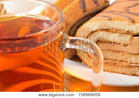 Sponge Cake With Chocolate Filling And Tea