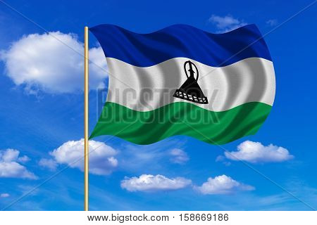 Lesotho national official flag. Basotho african patriotic symbol banner element background. Correct colors. Flag of Lesotho on flagpole waving in the wind blue sky background. Fabric texture. 3D rendered illustration