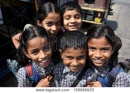 KOCHI, INDIA - FEB 15, 2009: Unidentified Indian schoolchildren having fun together after school on 15 February, 2009. Kerala state is Malayalam-speaking region with 33387677 inhabitants