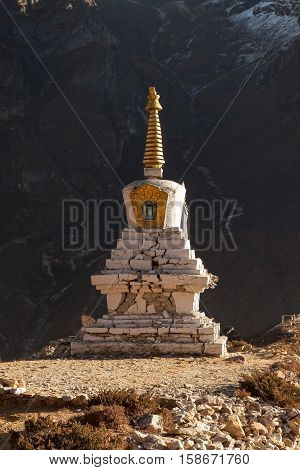 Buddhist Stupa In Thame Village With Rocky Mountain Wall On The Background, Sagarmatha National Park