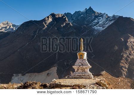 Buddhist Stupa In Thame Village With High Rocky Mountains On The Background, Sagarmatha National Par