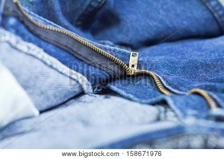 macro of a zip in a jeans