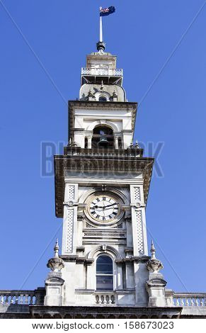 Dunedin Town Hall tower with a clock (New Zealand).