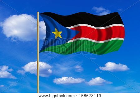 South Sudanese national official flag. African patriotic symbol banner element background. Correct colors. Flag of South Sudan on flagpole waving in the wind blue sky background. Fabric texture. 3D rendered illustration