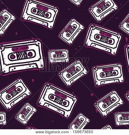 Modern seamless pattern with audio tapes. The pattern on a musical theme