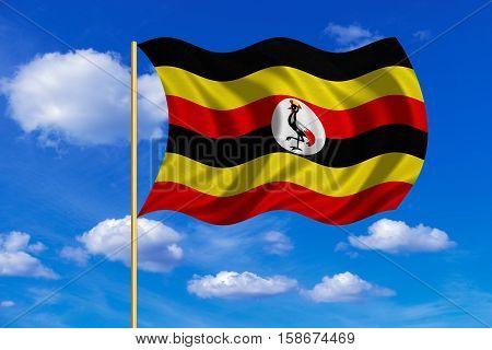 Ugandan national official flag. African patriotic symbol banner element background. Correct colors. Flag of Uganda on flagpole waving in the wind blue sky background. Fabric texture. 3D rendered illustration