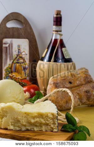 Best Italian food - fresh caciocavallo and pecorino cheese on olive wood board