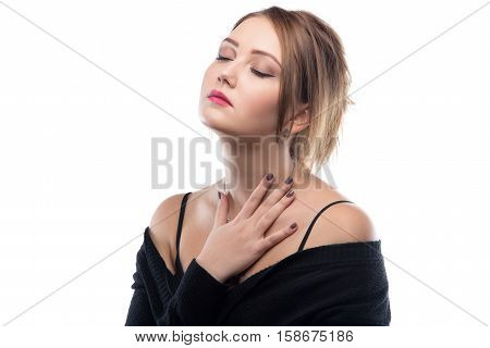 Blond woman with bare shoulders on white background