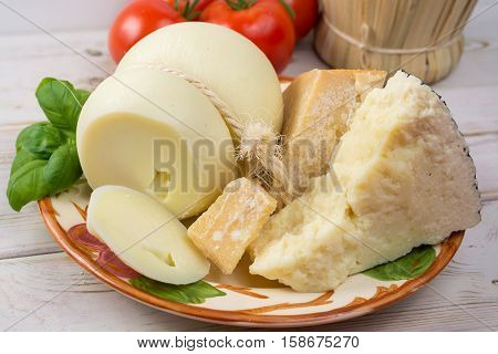Best Italian food - fresh caciocavallo pecorino parmesane cheese on ceramic plate