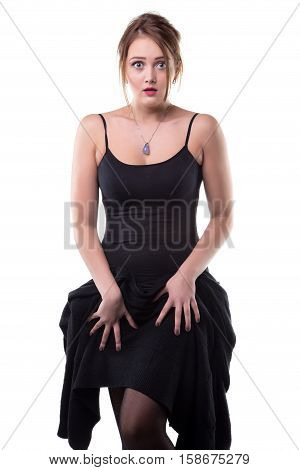 Shy young blond woman on white background