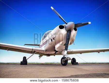 picture of a sports plane against a blue sky