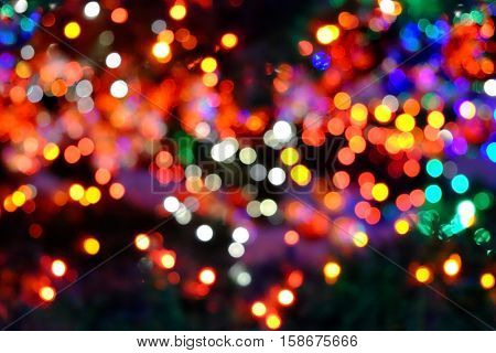 Beautiful colorful bokeh of the lights of the Christimas tree.