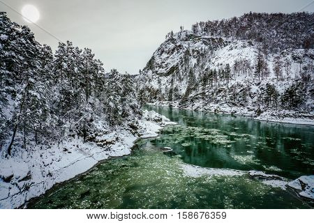 Mountain river Katun, Altay, Russia. A winter scenic.