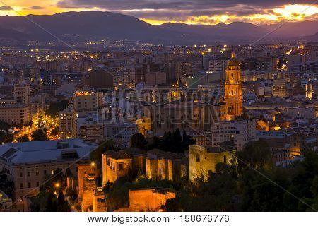 Cathedral and cityspace from castle in the night, Malaga, Andalusia, Spain